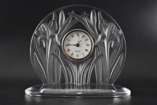 A Lalique clear and frosted glass Iris mantle clock, signed to rim, with original box, 27cm h