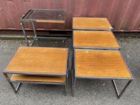 A nest of three Howard Miller for 'MDA' rectangular teak and chrome occasional tables, largest 48.5h