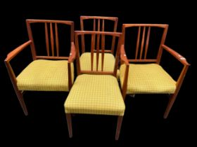 A set of four Gordon Russell 1950s teak dining chairs, model 6409 and 6408, designed by W.H Curly,
