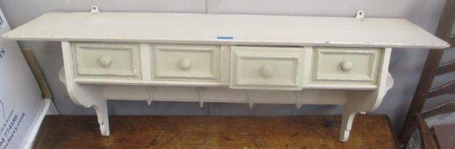 A painted pine shelf with four drawers and hooks, 42cm h x 104.5cm w