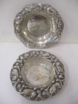 Two American silver dishes, each with embossed ornament, 121g