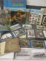 A mixed lot to include postcards, cigarette cards, stamps and scrap albums