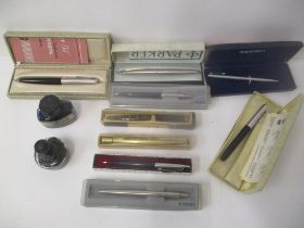 Writing implements to include Parker, Shafer, a Parker 51 fountain pen boxed, Conway pencil and