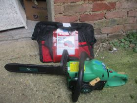 A Gardenline chainsaw together with a craftsman tool bag