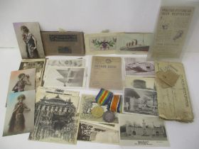 Militaria to include two World War I medals stamped M17716 EW Collette AR MTE RN, cards and papers