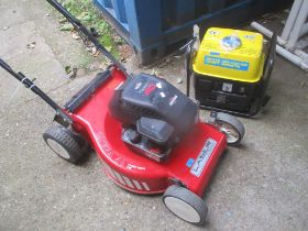 A Laser by Mountfield Omega 46 lawnmower together with a Powercraft 720W generator and accessories