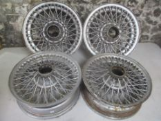 A set of four Curly Hub, 15 x 5 inch alloy wheels, possibly from a Jaguar