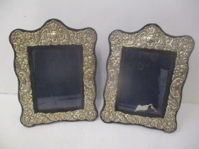 A pair of late 20th century silver fronted photograph frames with embossed decoration, 28cm h x 21cm