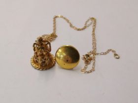 A 9ct gold bell shape pendant on chain together with a 10ct gold dress stud, 3.1g Location: Cab