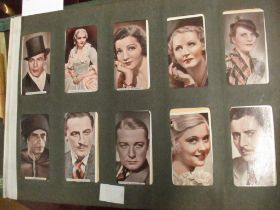 An early 20th century cigarette card album of mixed cards to include film stars Location: RAB