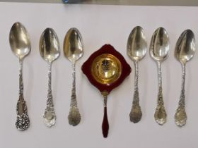 A Norwegian silver gilt and enamel tea strainer, together with a set of five sterling silver