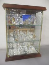 A selection of mainly Swarovski crystal animal ornaments (approx 28) contained in a glazed display