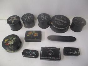 Black lacquered and mother of pearl inlaid boxes to include snuff boxes, trinket boxes and a glasses