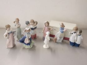 Four Lladro porcelain figures together with three Nao figures and a limited edition Royal Doulton