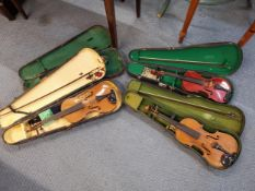 Three violins, one with label for 'Nicolaus Amatus Fecit in Cremona 16', together with four cases