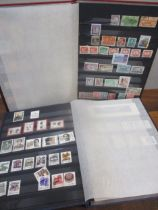 A stock book album of Chinese unfranked stamps to include Space Mission stamps, a stock book of