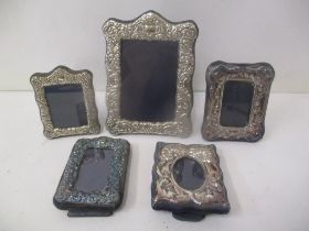 Five late 20th century silver fronted photograph frames with embossed decoration