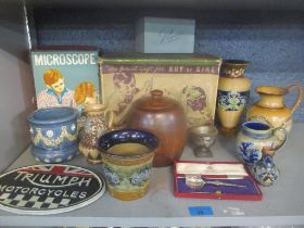 A mixed lot to include an American Flyer typewriter, microscope, Doulton Lambeth pottery, a cased