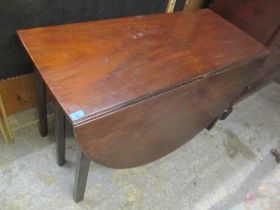 A George III mahogany drop leaf double gate action dining table, on square moulded legs, 72cm h x