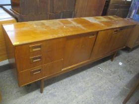 A mid 20th century retro teak sideboard having three drawers, one pull-down door and two sliding
