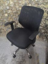 A fabric and plastic office chair on a chrome base
