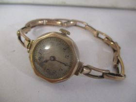 An early 20th century 9ct gold ladies wristwatch on a 9ct gold expanding bracelet 22.6g