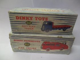Two boxed Dinky toys to include a 512 Guy Flat Truck and a 955 Fire Engine