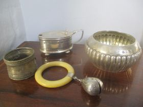 Mixed silver to include a gadrooned sugar bowl, silver and ivory baby rattle, napkin ring and a