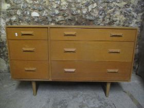 A mid 20th century retro stag Concorde light oak chest of drawers by John & Sylvia Reed having three