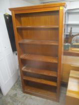 A modern William Lawrence of Nottingham walnut finished tall bookcase with five loose shelves 194.