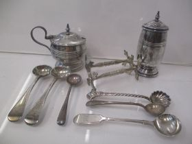 Silver condiments to include a pepper and a mustard, three mustard spoons, three salt spoons and a