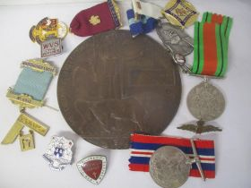 A selection of medals and badges to include a death plaque named Edwin George Bullock, Defence and