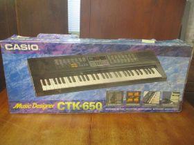A Casio CTK-650 boxed keyboard
