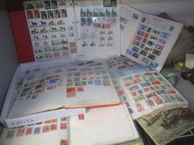 A selection of mixed stamps from around the world contained in albums and loose