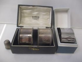 A pair of silver napkin rings, boxed, a napkin ring box and a thimble, 65g