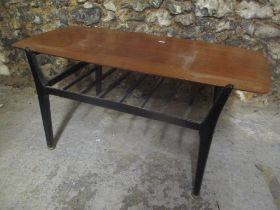 A 1970's retro Nathan teak topped coffee table having ebonised legs and railed magazine tier, 43.5cm