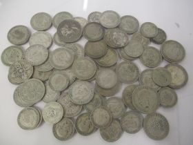 A collection of pre 1947 silver coins to include four half crowns, thirty florins and one