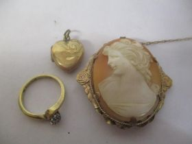 A 9ct gold diamond inset ring 2.5g, together with a cameo brooch, and a 9ct front and back locket