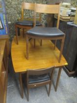 A mid 20th century retro teak extending dining table together with four matching chairs, 74cm h x
