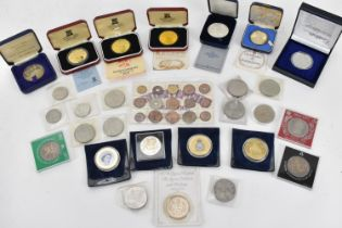 A group of commemorative boxed coins to include the sterling silver Princess Elizabeth and Prince