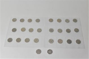 A collection of twenty six 50p pieces in sleeves to include the Kew Gardens 50p, London 2012