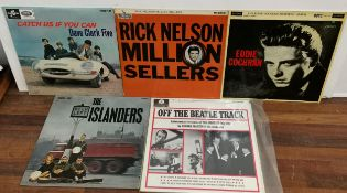 Five 1960's vinyl records to include Eddie Cochran, Off the Beatle Track, The Islanders, Rick Nelson