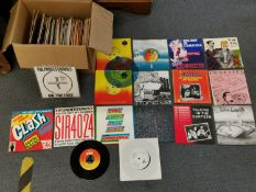 """A mixed collection of 7"""" vinyl singles to include The Clash, The Beatles, The Undertones, The"""