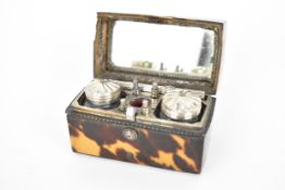 A 19th century tortoise shell cased travellers pen set, the arched topped box enclosing two