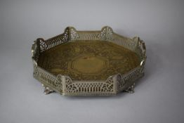 A Silver Plated Two Handled Octagonal Drinks Tray with Pierced Gallery Set on Four Short Scrolled