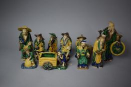 A Collection of Various Sanci Glazed Mud Men, Tallest 24cm High, Eight in Total