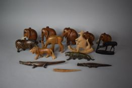 A Collection of Various Carved Wooden Animal Ornament to Include Elephants, Zebra, Lion, Crocodile