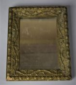A Small 19th/Early 20th Century Rectangular Gilt Framed Mirror with Floral Swag Decoration in