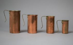 A Set of Four Copper and Brass Handled Cup Measures of Cylindrical Form, Largest 11.5cm high