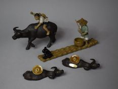 A Collection of Various Mud Men Figures to Include Mounted Boy on Water Buffalo, Fisherman on Bamboo